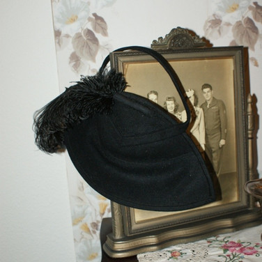 Half hat with feather
