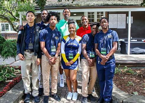 Jalen Rose and Isiah Thomas with students from Jalen Rose Leadership Academy at the Annual Golf Classic