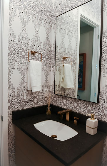 This formerly builder basic powder room was given a complete overhaul to reflect the cool, modern style of the family of four that lives there.  Photo credit: Molly Garg Photography