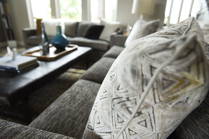 Our client came to us wanting a living room refresh featuring family friendly upholstery and new accessories, while showcasing some of their own personal art and memorabilia.