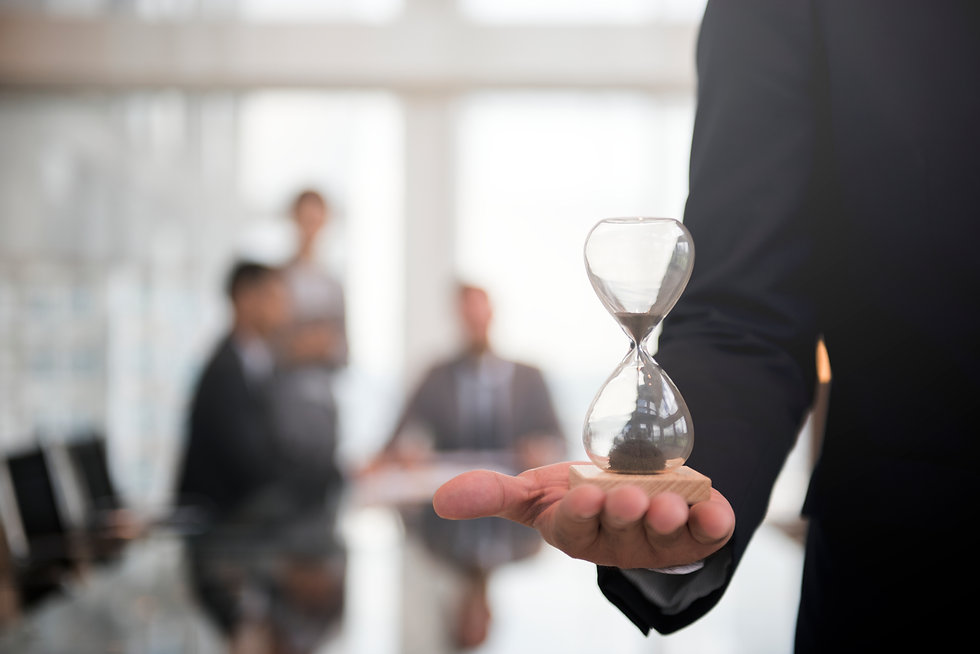 businessman-holding-an-hour-glass-signif