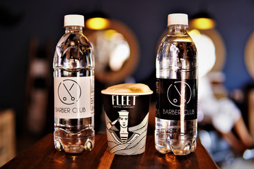 Enjoy an ice cold sparkling or still water or cappacino at Barber Club