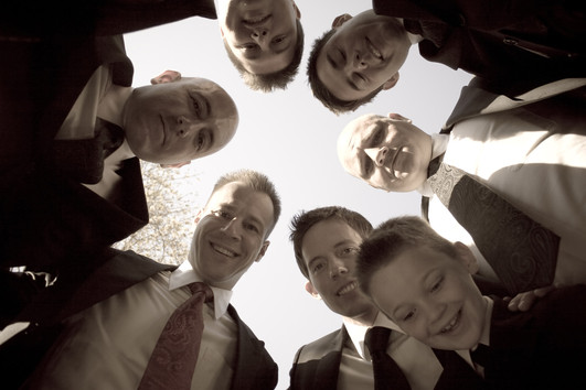 a-groom-and-his-groomsmen-posing-togethe