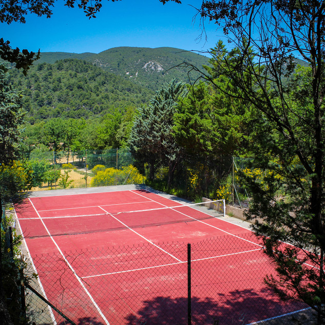 The villa's tennis court offers a spectacular view of the Luberon