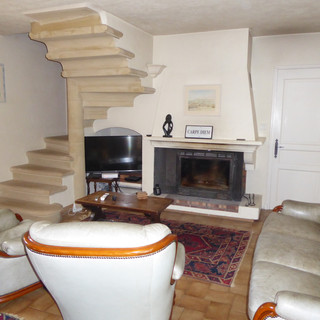 Striking circular stone staircase and Provençal fireplace at your Provence escape, La Jassine