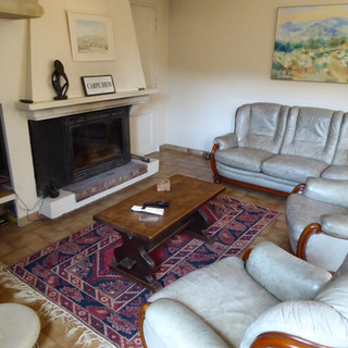 Provençal fireplace in living area of your Provence escape, La Jassine