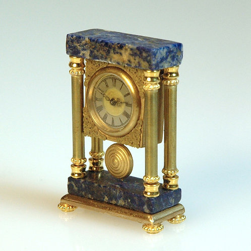 Blue Marble and Gold Clock
