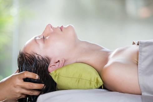 Head scalp massage in the spa salon.Shir