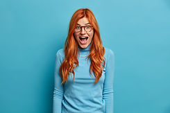 young-redhead-woman-with-shocked-express