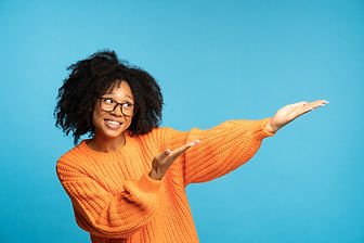 biracial-woman-with-curly-hair-in-orange-jumper-po-RWSYAZR.jpg