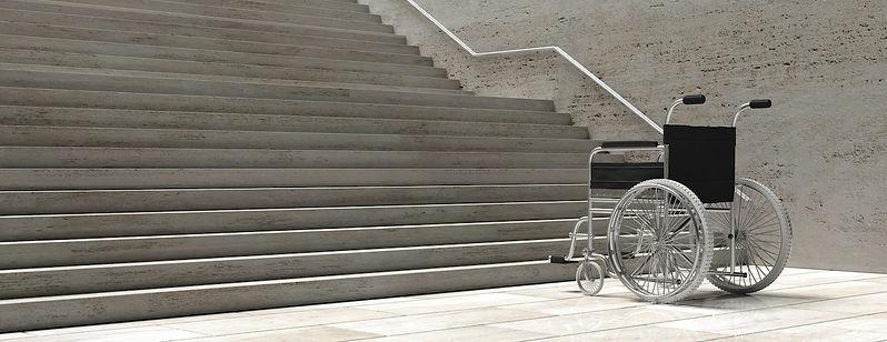 wheelchair-empty-infront-of-concrete-sta