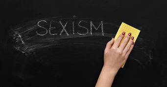 sexism-written-on-chalkboard-and-hand-wi