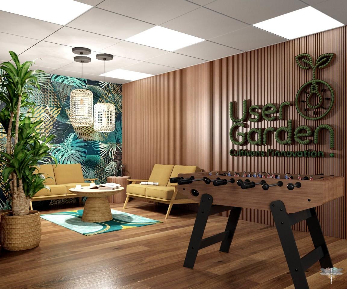 Aménagement et décoration d'un espace de bureaux professionnels à Lille par Carnets Libellule. Coralie Vasseur est votre architecte d'intérieur UFDI à Compiegne : salon d'attente et accueil avec logo végétal et baby-foot pour cette startup qui propose de la location de workspace