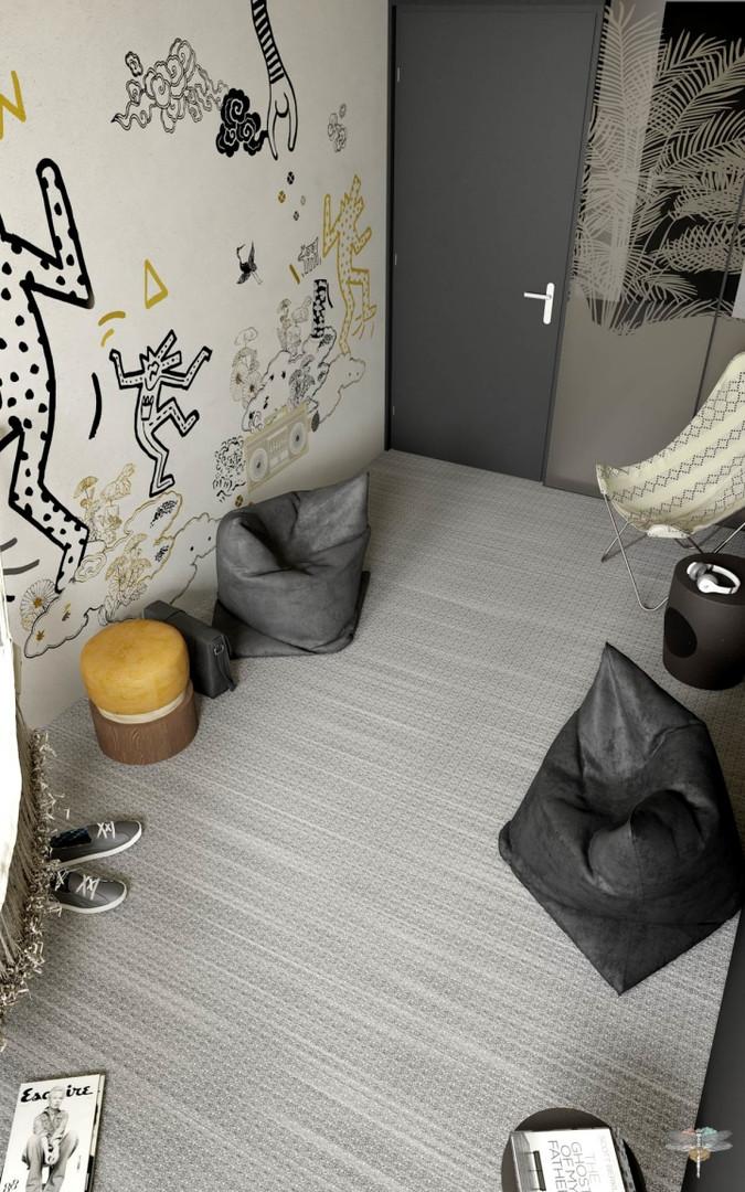 Aménagement et décoration d'un espace de bureaux professionnels à Lille par Carnets Libellule. Coralie Vasseur est votre architecte d'intérieur UFDI à Compiegne : salle de pause au papier peint graphique et complètement modulable avec poufs et bouts de canapé
