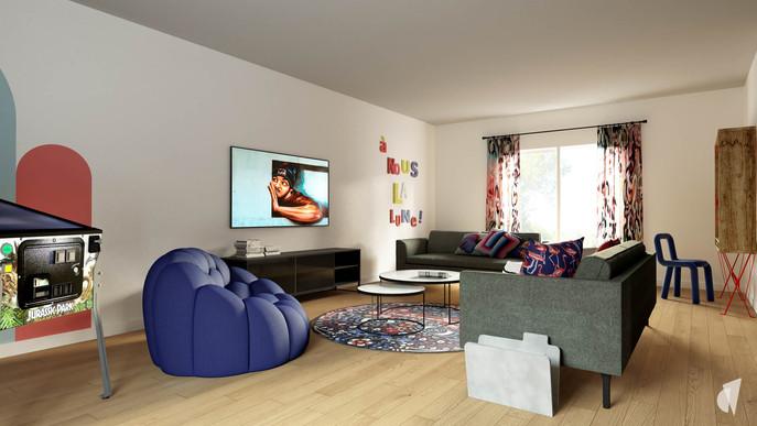 Aménagement et décoration d'un loft industriel street art à Genève, par le Studio Coralie Vasseur. Coralie Vasseur est votre architecte d'intérieur et décoratrice UFDI à Annecy, Genève et en Haute Savoie : vue d'ensemble sur le salon avec le fauteuil de designer bleu, chaise de designer et tapis graphique