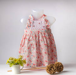 Pink dress with flowers on manneqin.jpg