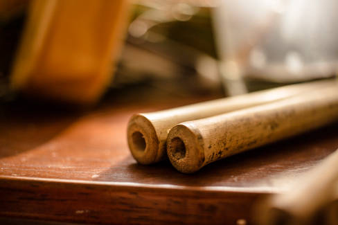 BAMBOO STRAWS ON A SURFACE CLOSE UP.jpg