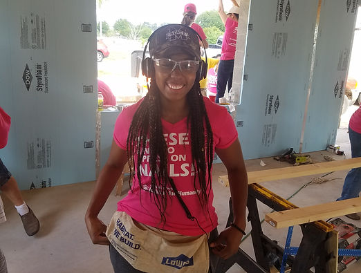 Girl Volunteer At A Construction Site