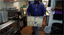 woman carrying boxes of milk at Johnathan's Sandwich House
