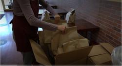 Johnathan's Sandwich House employee arranging meals