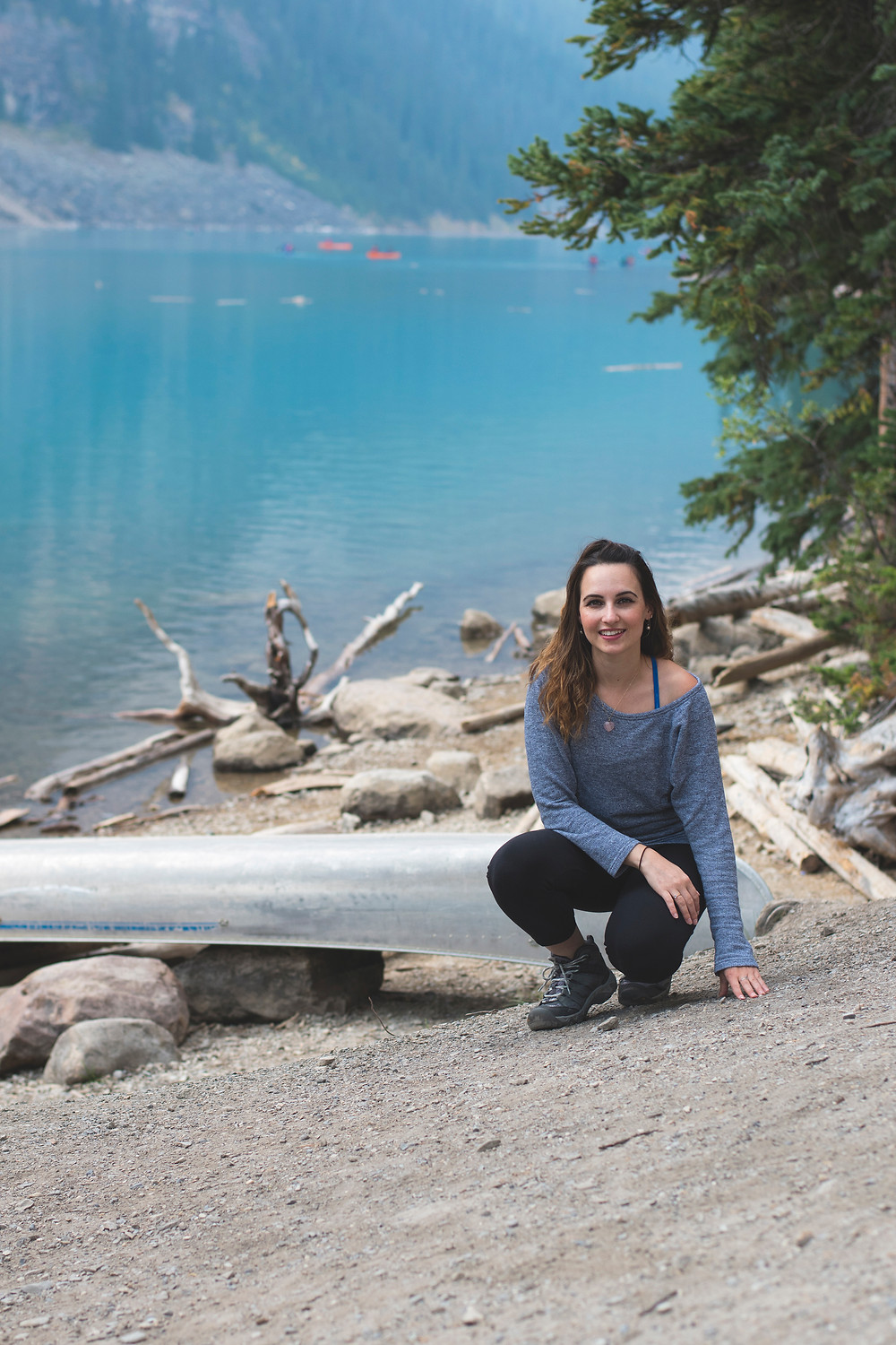 A girl at the shore of Moraine Lake
