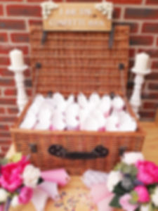 Large wicker hamper filled with confetti cones