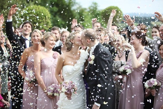 A confetti photograph with a newly married couple