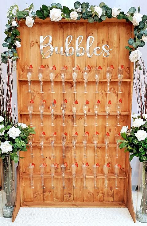 'Bubbles' Rustic Prosecco Wall with Champagne Glasses