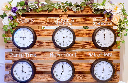 Rustic Order of the Day featuring clocks, decorated with floral garlands