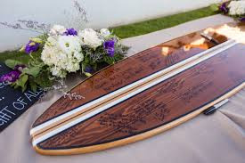 A wooden surfboard, signed by guests as an alternative wedding guest book