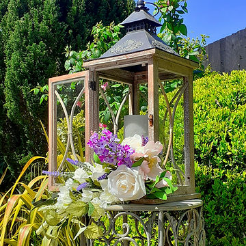 Large rustic lantern with silk flower decorations