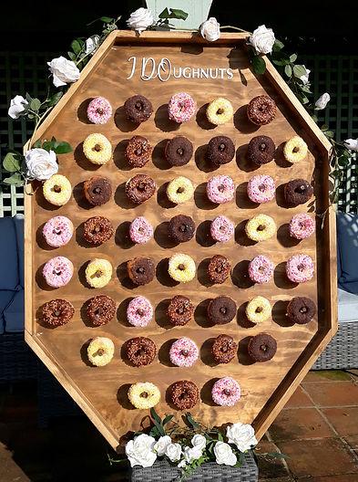 Bespoke rustic doughnut wall holding 96 mixed ring doughnuts