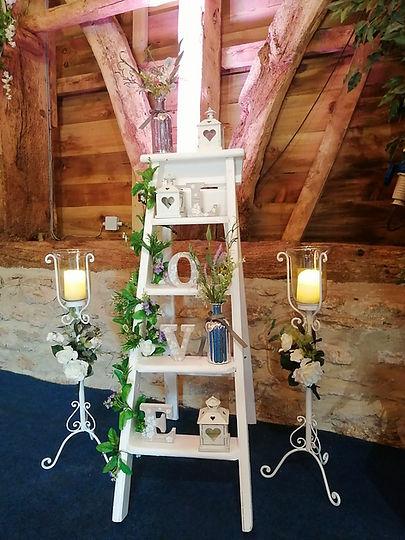 White Wedding Ladder decorated with wedding accessories