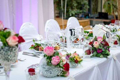 Wedding top table dressed with crystalware and flowers