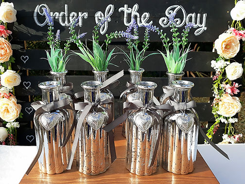 Mercury silver glass bottles decorated with silver hearts, ribbon and lavender