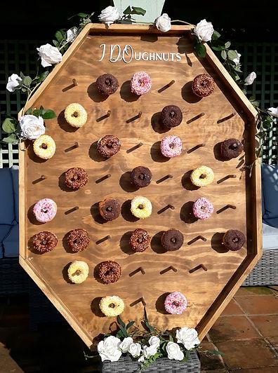 Bespoke doughnut wall with iced ring doughnuts