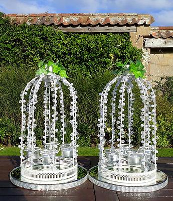 Crystal & pearl wedding tea-light lanterns, sitting on large crystal mirror plates