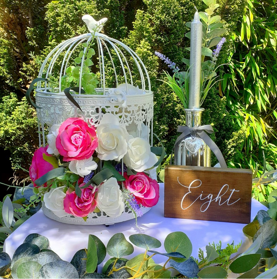 A floral birdcage centrepiece from The Wedding Library