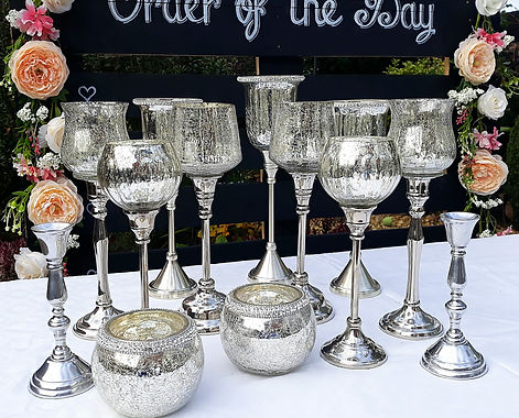Silver mercury candleholders and goblets