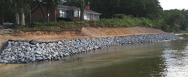 a completed riprap job with a newly graded slope