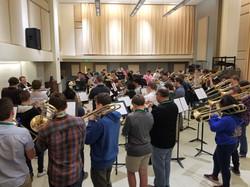 Mass brass ensemble rehearsing