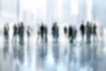 Blurred people mingling