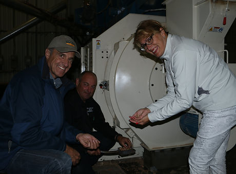 Valfei Owners holding wood pellets in their hands