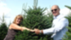 Colette Martineau and Serge Vaillancourt holding a Fraser Fir Christmas Tree