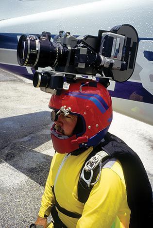 "Legendary aerial cinematographer Tom Sanders, has filmed skydiving scenes for dozens of movies, including ""Drop Zone,"" many James Bond films and the original ""Point Break,"