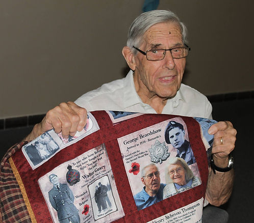 George Beardshaw with his quilt.jpg
