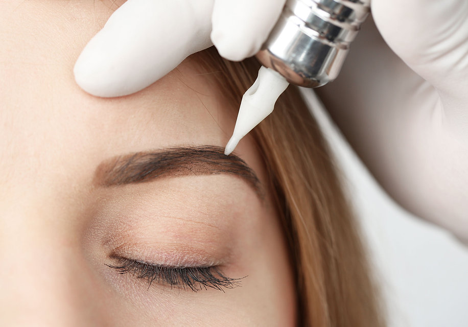 permanent eyebrow makeup being applied