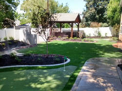outdoor living space, turf, concrete
