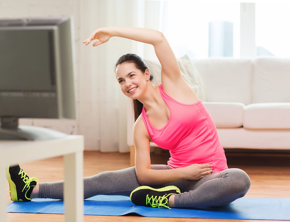 Girl stretching after a virtual fitness session by
