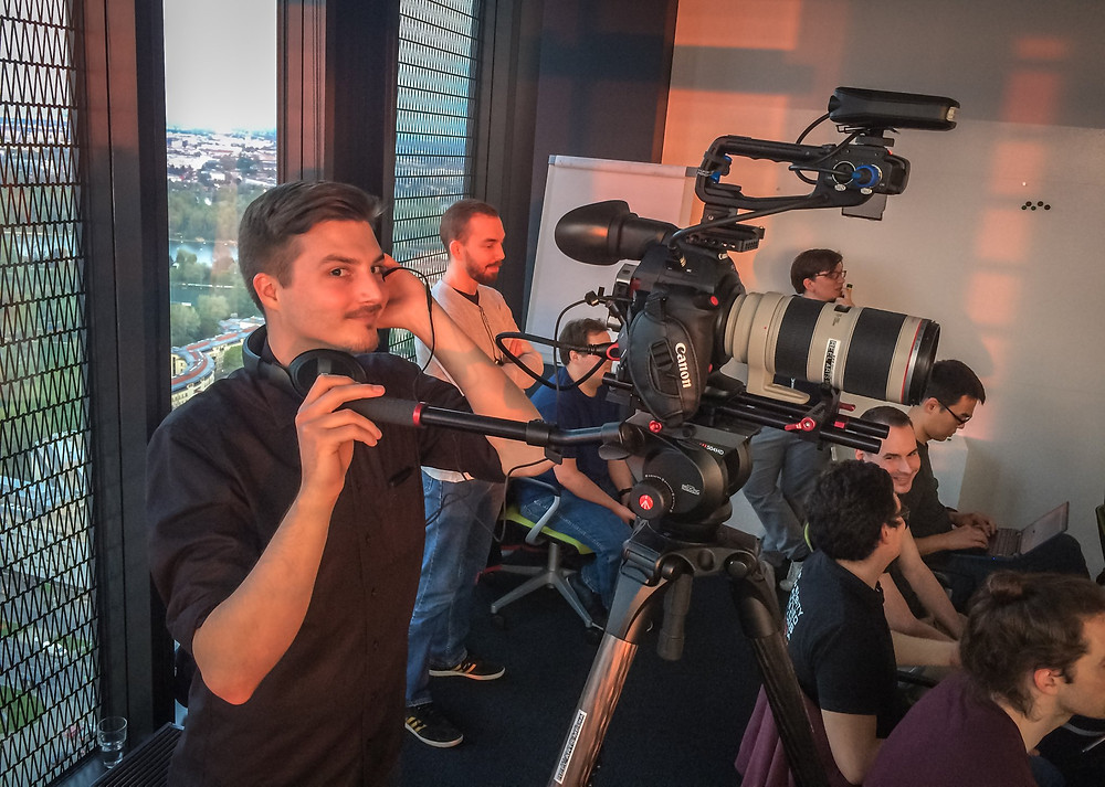 Camera Operator Filming a Conference Talk
